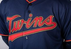 """Twins replace cream-colored home uniforms with navy blue, scarlet red and yellowy trim the Twins call """"MN Kasota Gold"""" Thumbnail"""