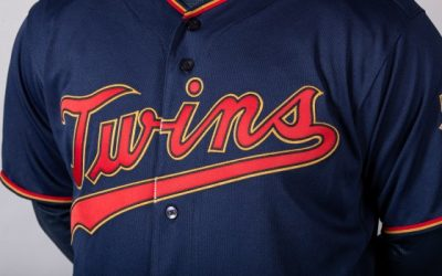"Twins replace cream-colored home uniforms with navy blue, scarlet red and yellowy trim the Twins call ""MN Kasota Gold"""